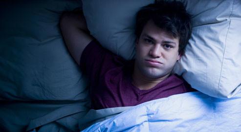 getty_rf_photo_of_man_having_trouble_sleeping